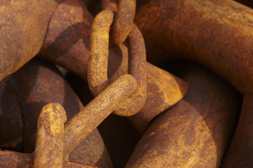 Iceland. Rusted metallic chains close up.