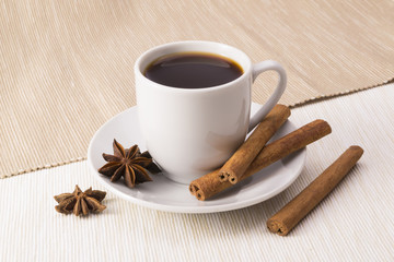 Cup of coffee with cinnamon and star anise