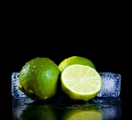 fresh lime with ice cubes with space for text