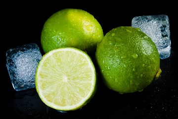 close-up of fresh lime with ice cubes