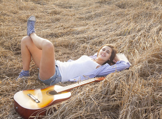 Obraz Portrait of young Country latin hispanic brunette girl laying ne - fototapety do salonu