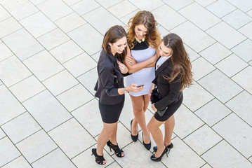 Successful businesswomen in the city, top view