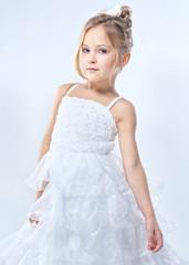 portrait of a pretty little girl in the studio