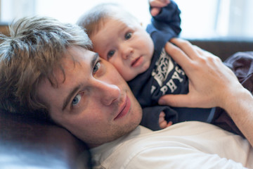 Man playing with his baby son
