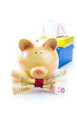 Piggy bank with a banknote bow and gift boxes