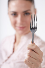woman with spoon and fork