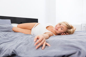 Beautiful woman lying on bed home