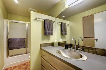 Bright bathroom with glass door shower