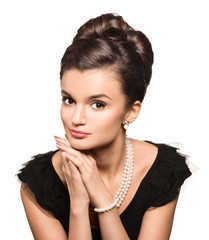 portrait of beautiful brunette woman wearing pearl  jewelry. loo