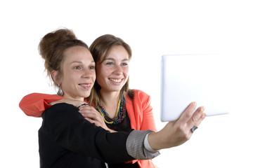 two pretty teen girls taking selfies with her digital tablet