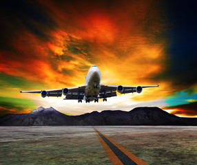 Tuinposter jet plane flying over runways and beautiful dusky sky with copy