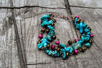 wrist bracelet of beads and precious stones