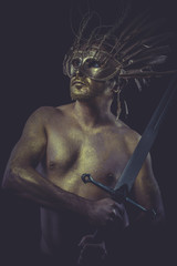 Protection, golden deity, man with wings and gold helmet