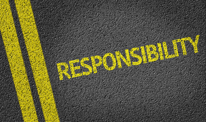 Responsibility written on the road