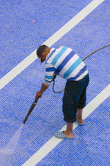 Worker cleaning the pool