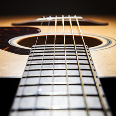 acoustic guitar detail on black background