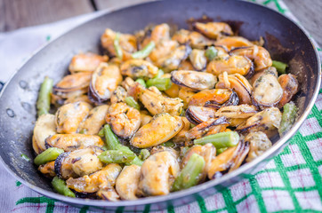 Fried mussels on the pan