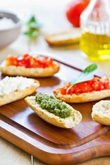 Crostini with Pesto, Cheese,and Tomato