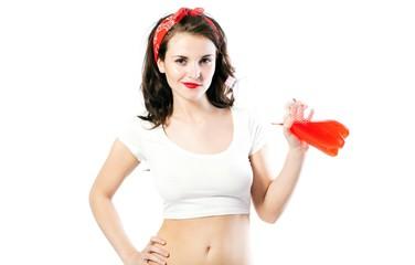Pretty young woman in tshirt drinking orange soda