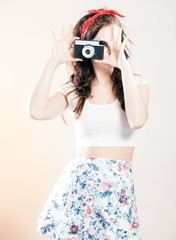 Pretty pin up girl vintage camera taking picture