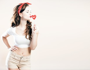 Pin up girl, valentine lollipop in shape of heart