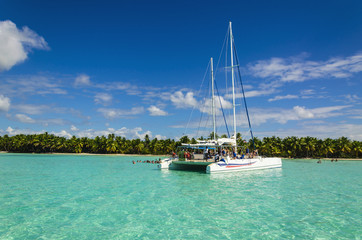 White catamaran on azure water against blue sky
