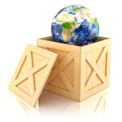 Planet Earth in a wooden box. Isolated on white background.