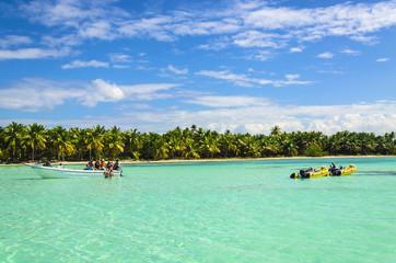Yellow boats and people having fun onazure water