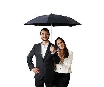 happy smiley couple under black umbrella