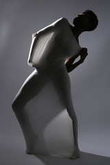 Shapely Woman in Creative Light and Spandex Fabric