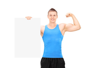 Muscular man holding a banner and showing bicep