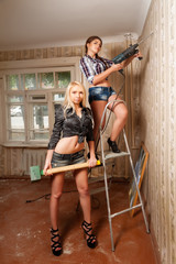 Attractive women with puncher and hammer