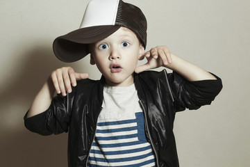 Funny little boy.Hip-Hop Style.fashion children.Child in Cap