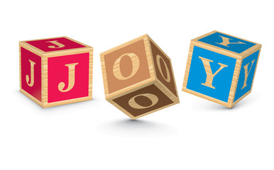 Word JOY written with alphabet blocks