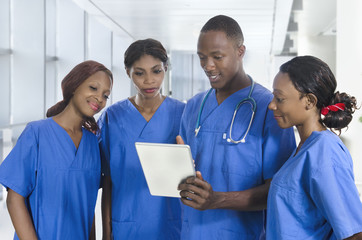 African physician team with tablet PC