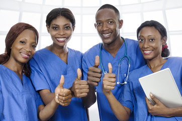 African physician team thumbs up