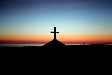 Silhouette cross on chapel