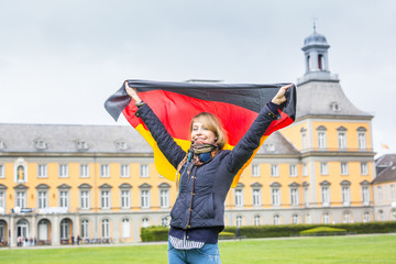 German Girl with Flag in front of Bonn University