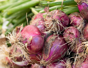 Red onions on a market