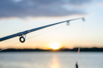 Ingelijste posters Vissen fishing on a lake before sunset