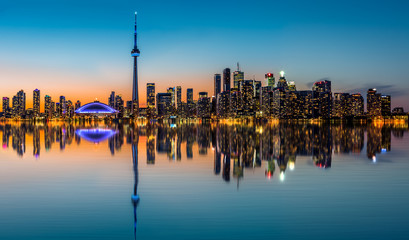 Wall Mural - Toronto skyline at dusk reflected in the Inner Harbour Bay
