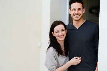 happy young couple welcome in new home