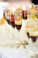 Tall glasses of assorted chocolate cream desserts