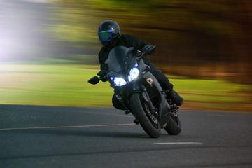 young man riding big bike motorcycle on asphalt high way against