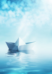 Paper boat on azure water