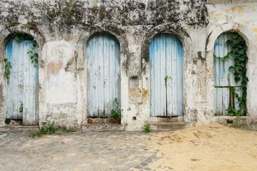 Old doors on grunge wall