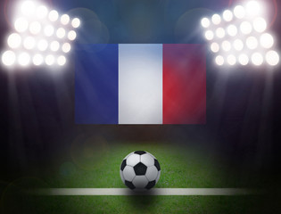 Soccer Ball with France Flag in stadium.