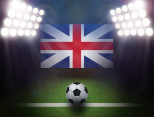 Wall Mural - Soccer Ball with United Kingdom Flag in stadium.
