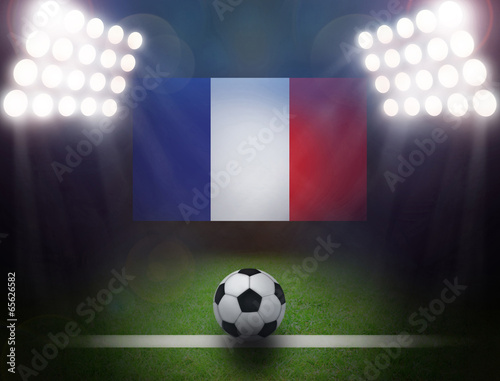 Wall mural Soccer Ball with France Flag in stadium.