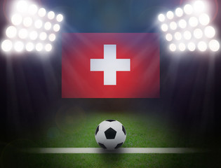 Wall Mural - Football with Switzerland Flag in stadium.